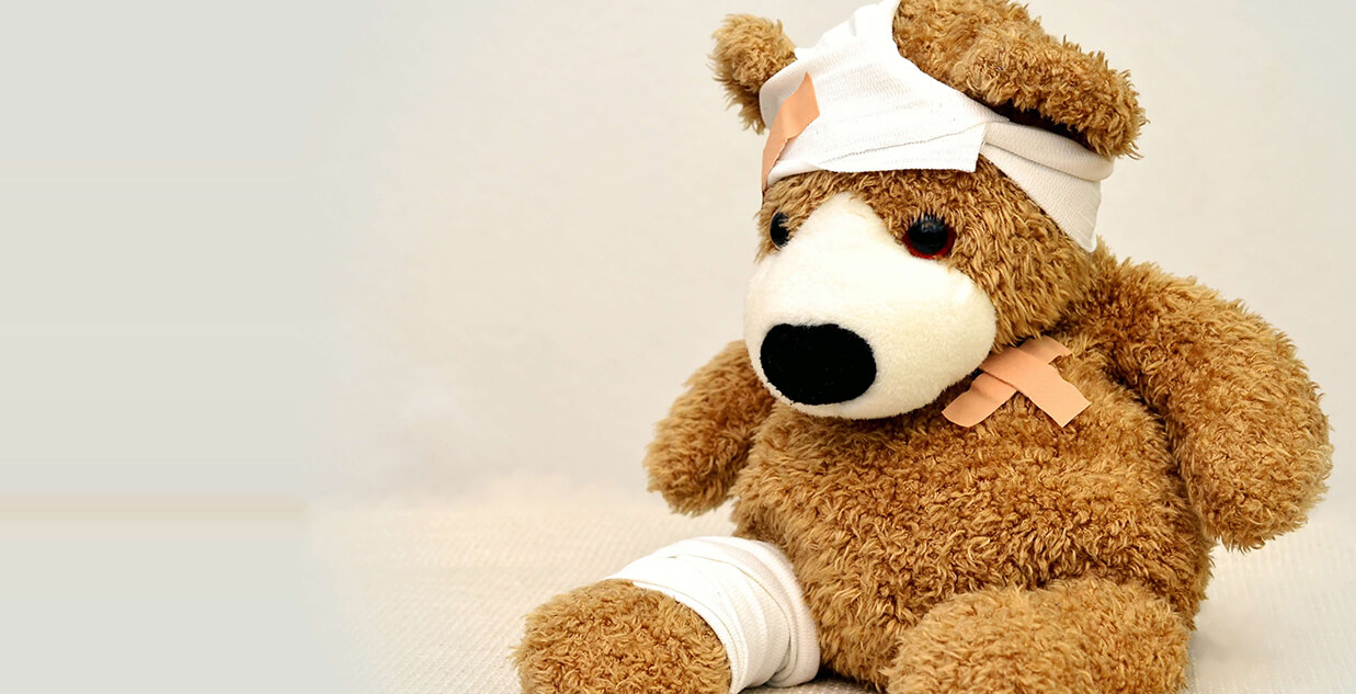 injured plush bear